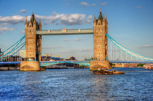 Stock Photo: 4282-17079 England, London, Tower Bridge. Tower Bridge, one of London's most iconic landmarks spanning the River Thames. The bridge was designed by Sir Horace Jones and Sir John Wolfe Barry and completed in 1894.
