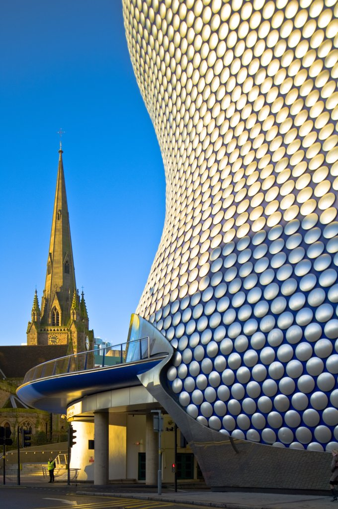 Stock Photo: 4282-17166 England, West Midlands, Birmingham. The aluminium disc clad exterior of Selfridges iconic store at the Bullring and St Martin's Church at sunrise.