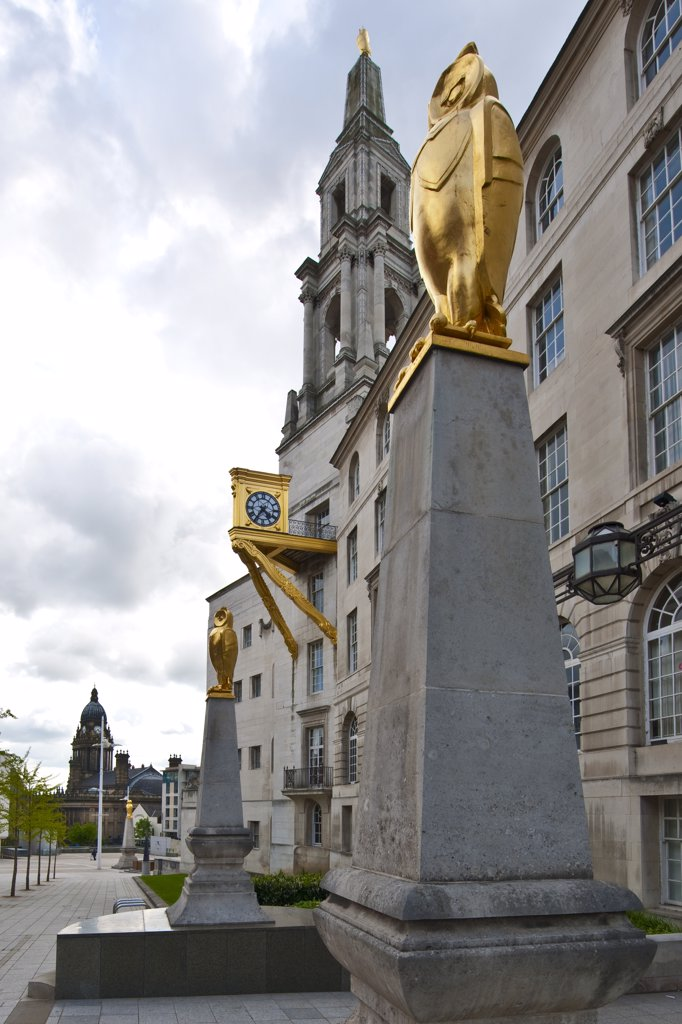 Stock Photo: 4282-17183 England, West Yorkshire, Leeds. Gilded Owl sculptures on top of Portland stone obelisks outside Leeds Civic Hall.