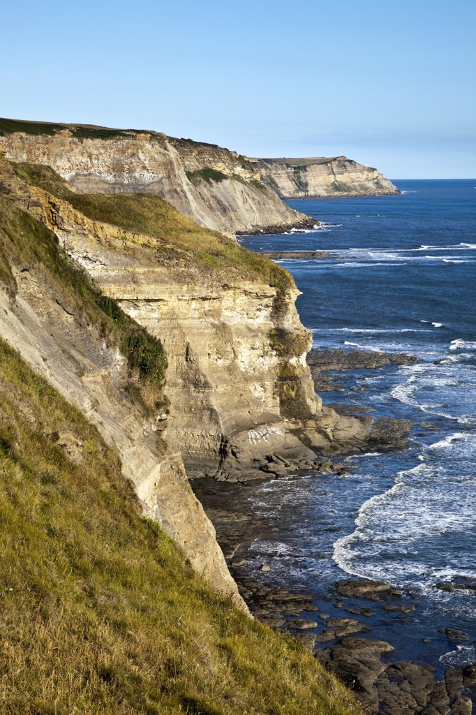 Stock Photo: 4282-17489 England, North Yorkshire, Robin Hood's Bay. Steep cliffs on the North Yorkshire Coast, by the North Sea.