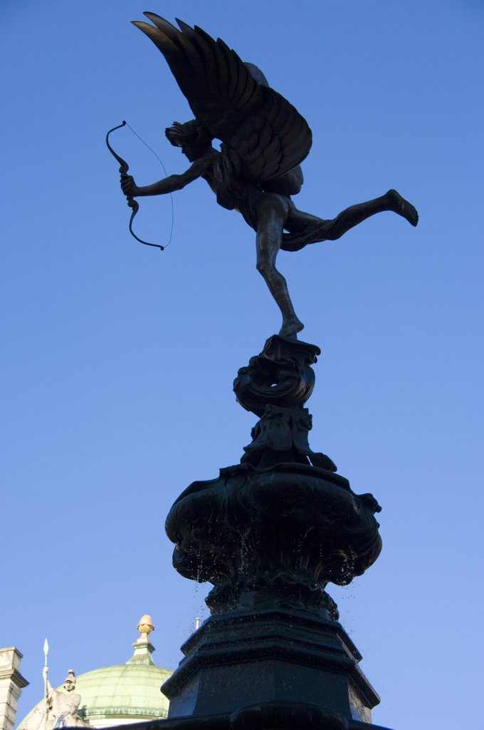 Stock Photo: 4282-17538 England, London, Piccadilly Circus. Silhouette of the statue of Eros on the Shaftesbury memorial fountain at Piccadilly Circus in London's West End.
