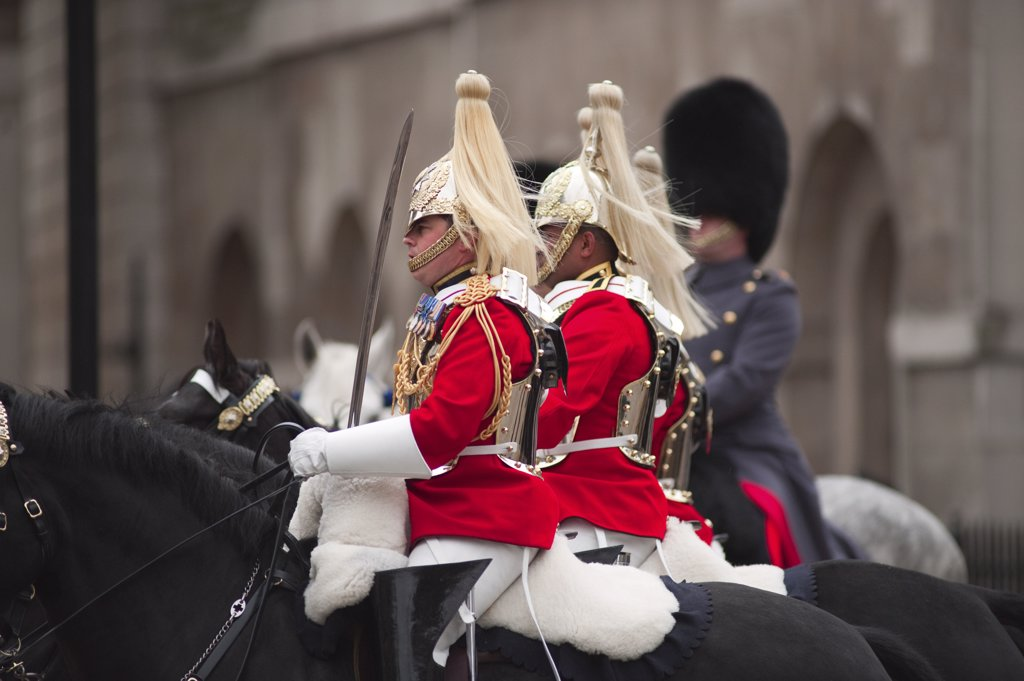 England, London, Westminster. Life Guards on horseback enter Whitehall from Horseguards Parade during the State Opening of Parliament in central London. : Stock Photo