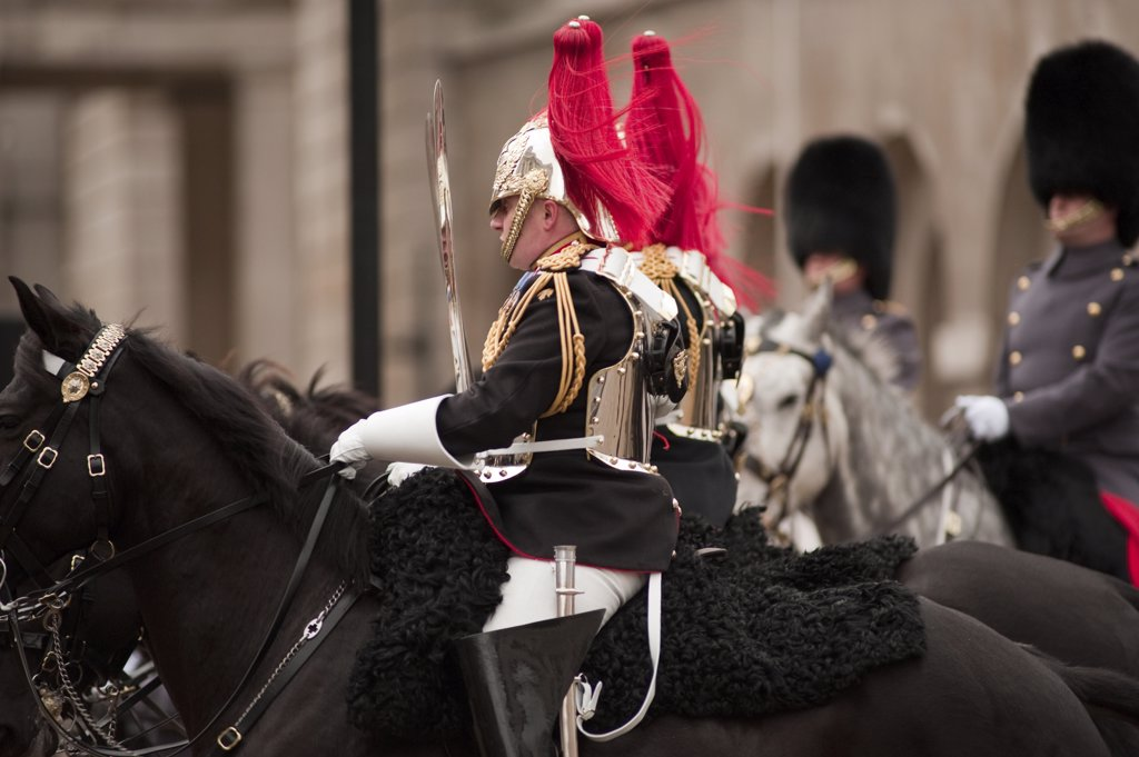 Stock Photo: 4282-17622 England, London, Westminster. Blues and Royals on horseback enter Whitehall from Horseguards Parade during the State Opening of Parliament in central London.