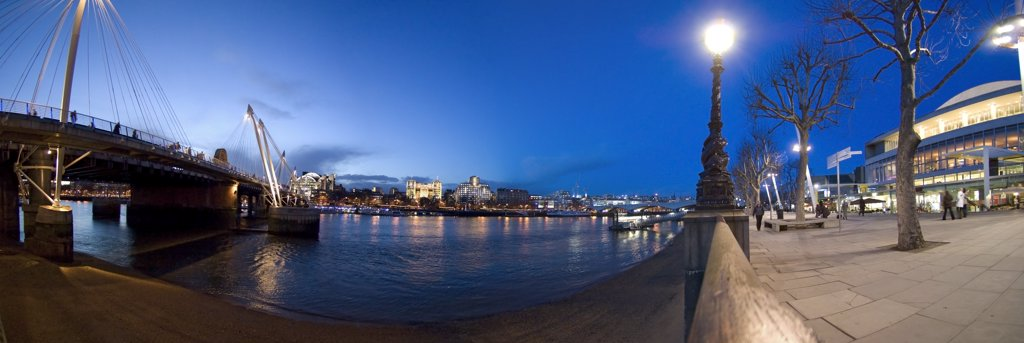 England, London, South Bank. Evening panoramic view of the river Thames in London from the South Bank featuring the Golden Jubilee footbridge and Royal Festival Hall. : Stock Photo