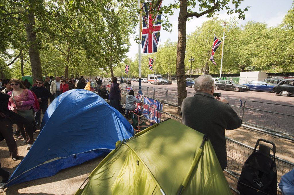 Stock Photo: 4282-17785 England, London, The Mall. People camped on The Mall along the Royal Wedding route a day before the big event in Central London.