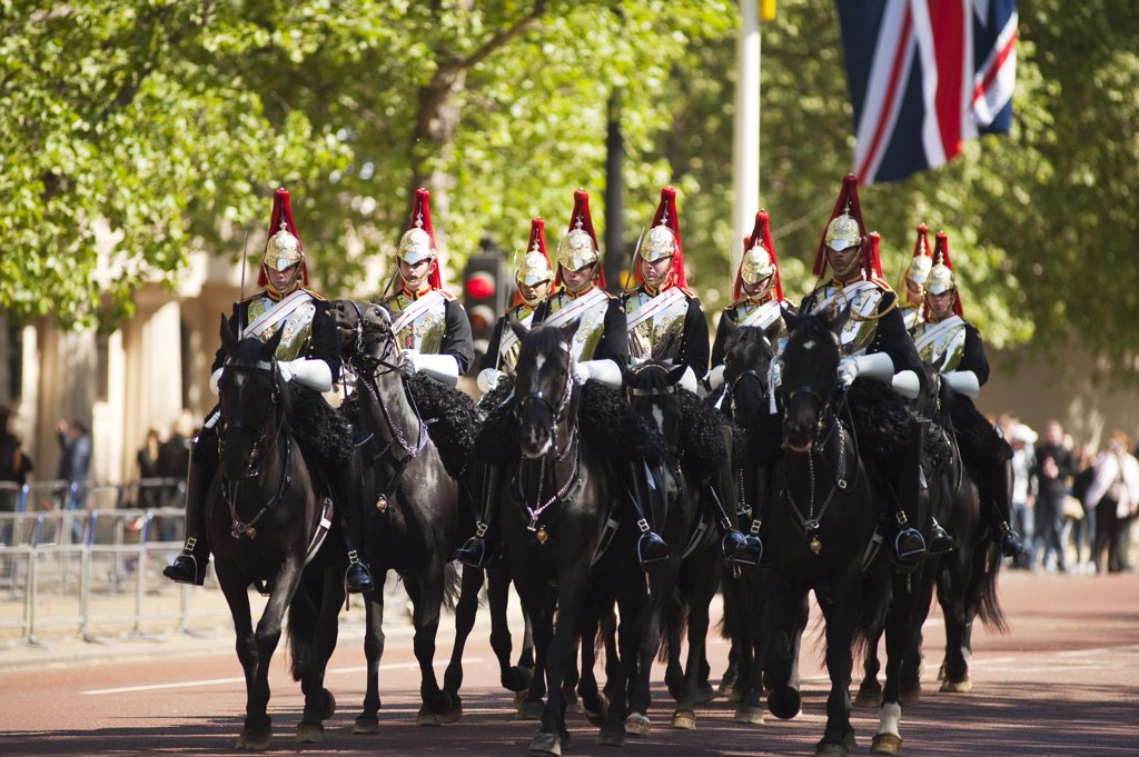 Stock Photo: 4282-17817 England, London, The Mall. Guards of the Blues and Royals troop down The Mall, decorated in large Union flags for the Royal Wedding between Prince William and Catherine Middleton.