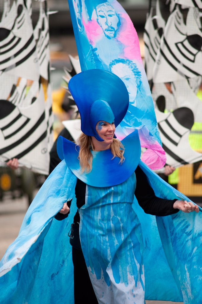England, London, City of London. A woman wearing a costumed based on the theme 'the Necessities of Life' from the City of London Solicitors Company float in the procession at the annual Lord Mayor's Show in the City of London. : Stock Photo