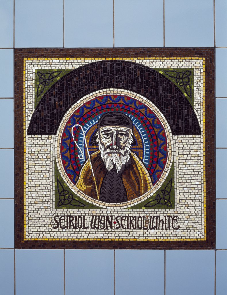 Wales, Anglesey, Holyhead. Mosaic of St Seiriol of Penmon, designed by Gary Drostle, at the Market Street entrance to the Celtic Gateway bridge which links the town centre with the railway station and ferry terminal. : Stock Photo