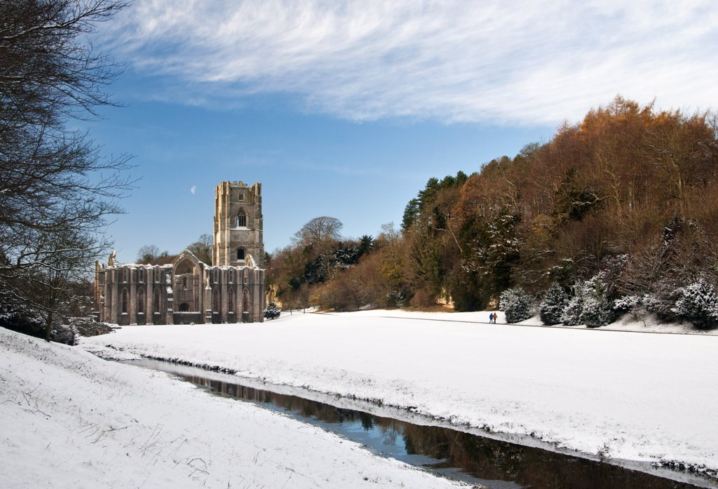Stock Photo: 4282-18343 England, North Yorkshire, Fountains Abbey. Snow covering the ground around the 12th century ruins of Fountains Abbey, the largest monastic ruins in England.