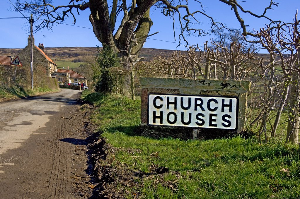 England, North Yorkshire, Church Houses. Stone road sign outside the village of Church Houses in Farndale. : Stock Photo