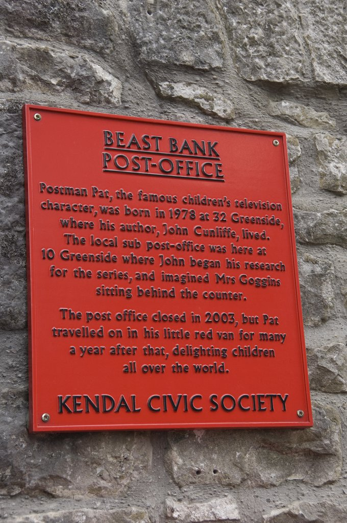 Stock Photo: 4282-18851 England, Cumbria, Kendal. A plaque outside the old Beast Bank post office in Kendal where John Cunliffe, author of Postman Pat, began his research for the series.