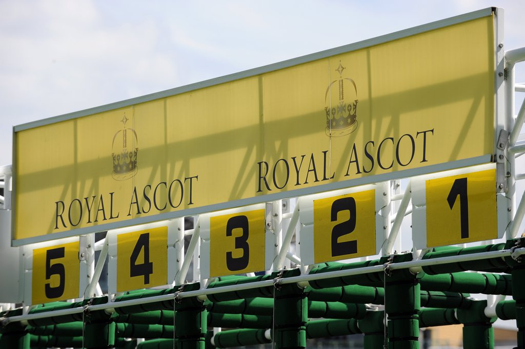 Stock Photo: 4282-19109 England, Berkshire, Ascot. Royal Ascot signage on the top of the starting stalls at Royal Ascot 2010.
