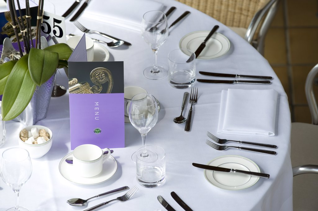 Stock Photo: 4282-19212 England, London, Wimbledon. A table setting in the members restaurant during the Wimbledon Tennis Championships 2010.