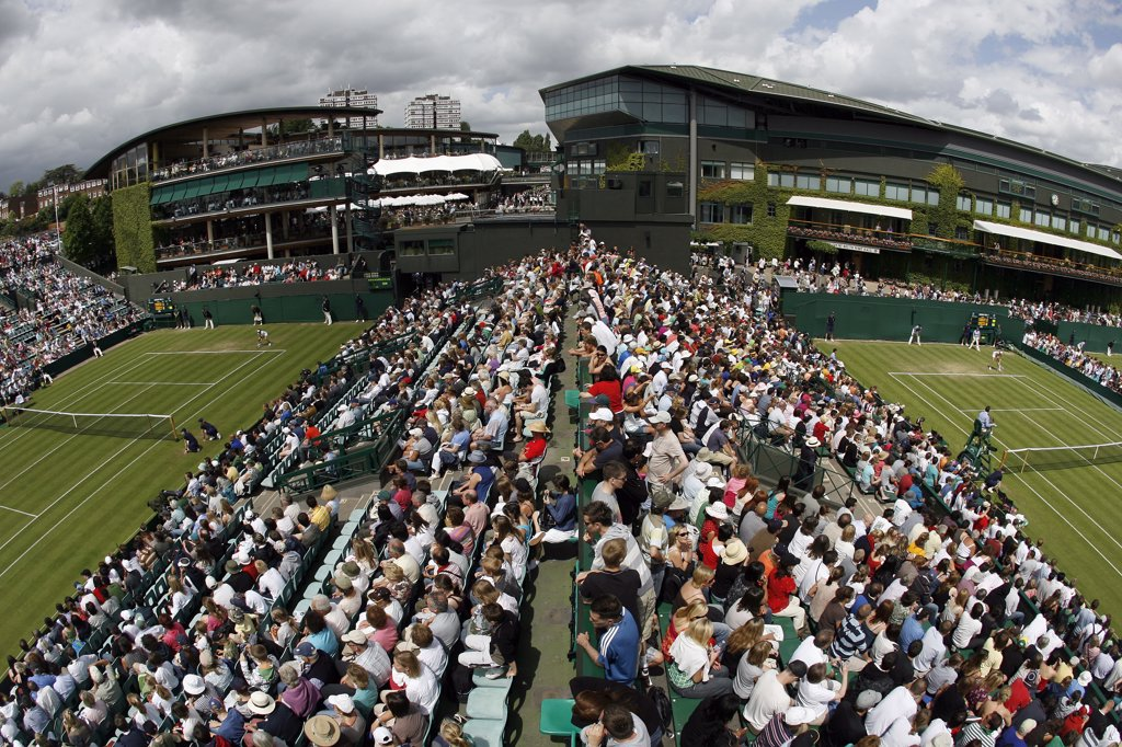 Stock Photo: 4282-19381 England, London, Wimbledon. View from the crows nest of the crowds watching games on Court 2 and Court 3 during the Wimbledon Tennis Championships 2008.