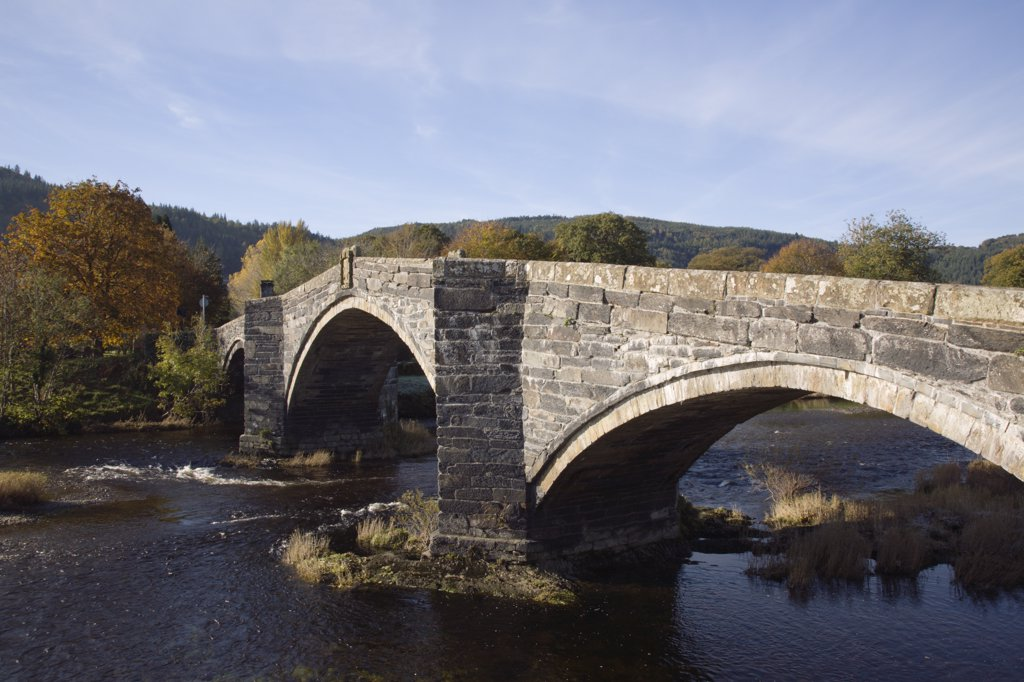 North Wales, Conwy, Llanrwst. The River Conwy flowing under the Pont Fawr bridge. : Stock Photo