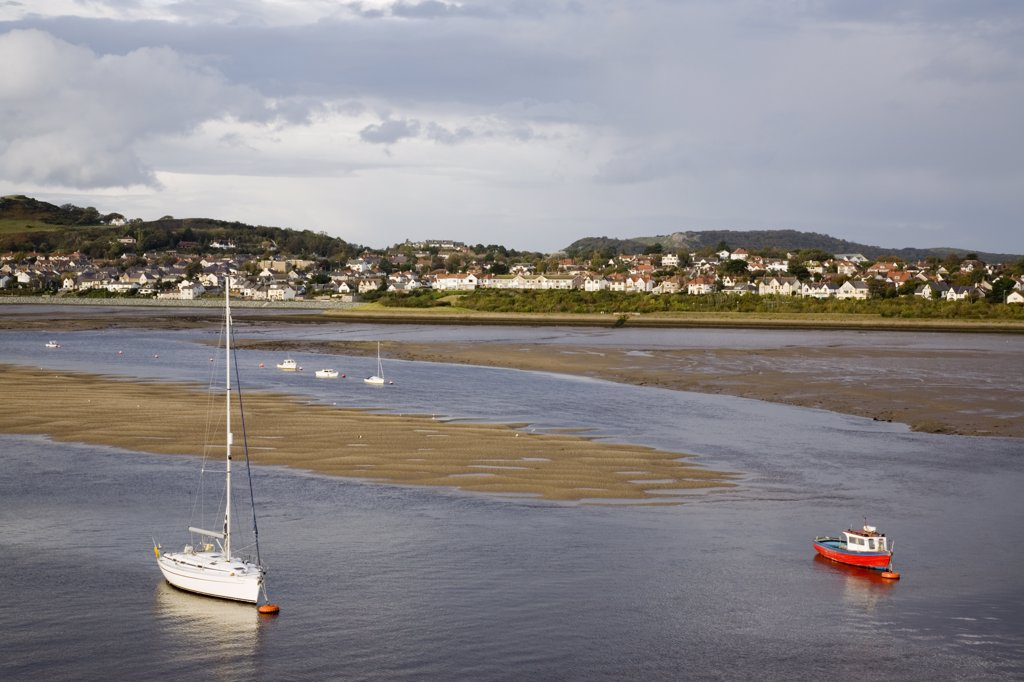 North Wales, Conwy, Conwy. View across river estuary toward Deganwy. : Stock Photo
