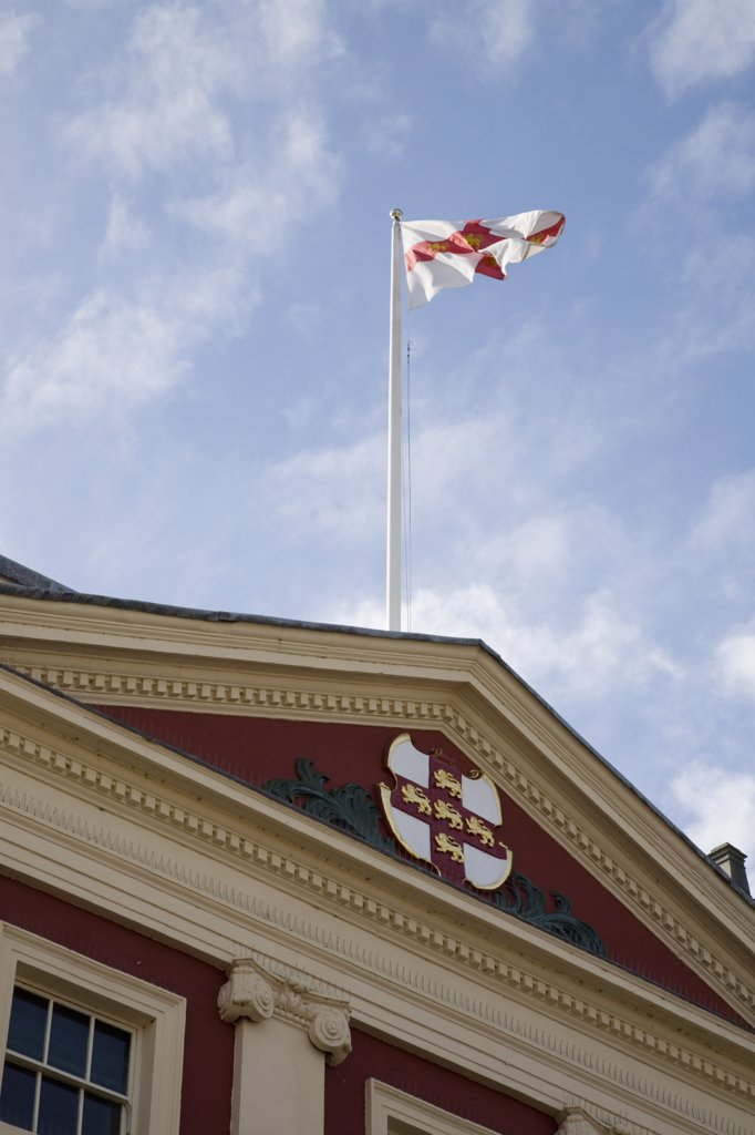 Stock Photo: 4282-19617 England, Yorkshire, York. Flag of St George flying on Town Hall roof in city centre.