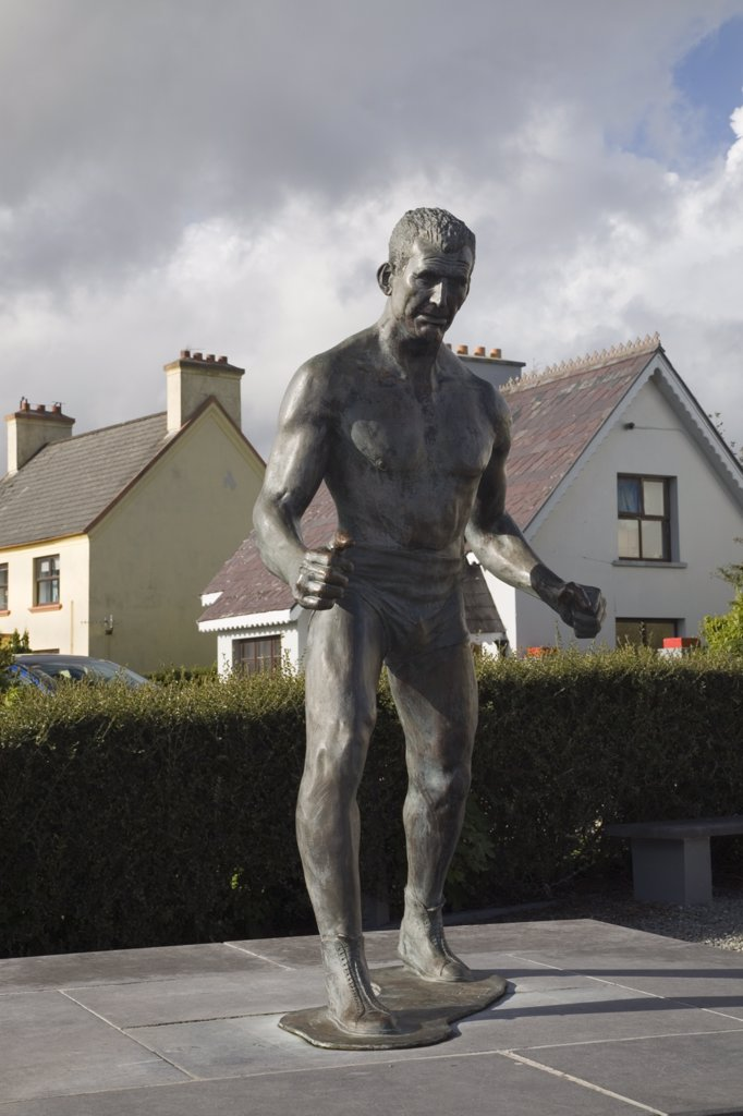 Stock Photo: 4282-19630 Republic of Ireland, County Kerry, Sneem. Statue of Steve 'Crusher'  Casey in South Square on Ring of Kerry tourist route round Iveragh Peninsula.  Undefeated Heavyweight wrestling champion of world from 1938 to1947.
