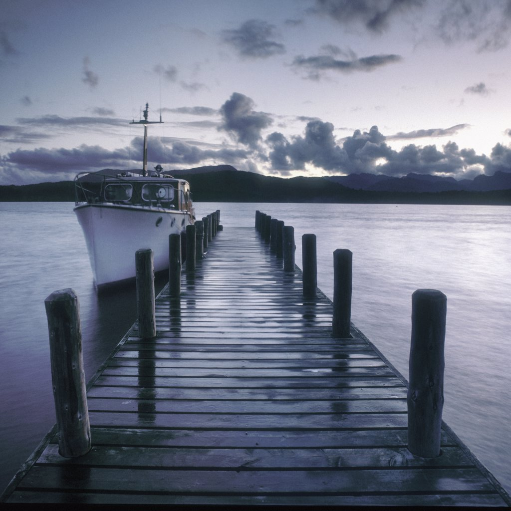 Stock Photo: 4282-20138 England, Cumbria, Lake Windemere. A pier at dusk on Lake Windemere.
