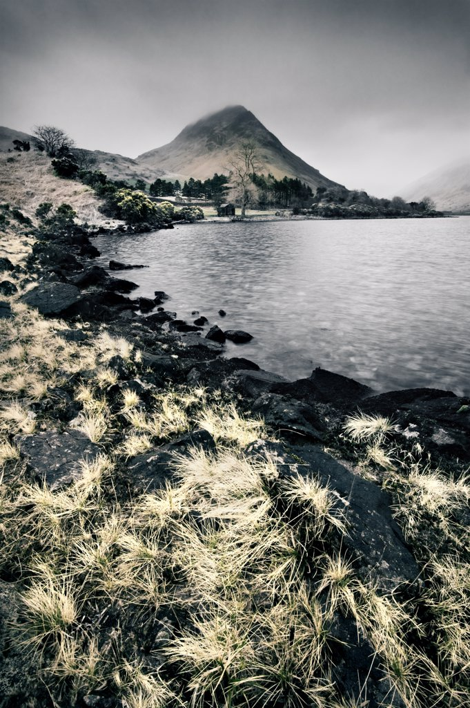Stock Photo: 4282-20180 England, Cumbria, Wastwater. A view across Wastwater in the Lake District. Wastwater is England's deepest lake and lies at the foot of England's highest mountain, Scafell Pike.