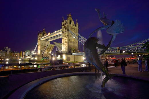 Stock Photo: 4282-20433 England, London, Tower Bridge. Girl with a Dolphin by David Wynne 1973 on the north side of the River Thames by Tower Bridge.
