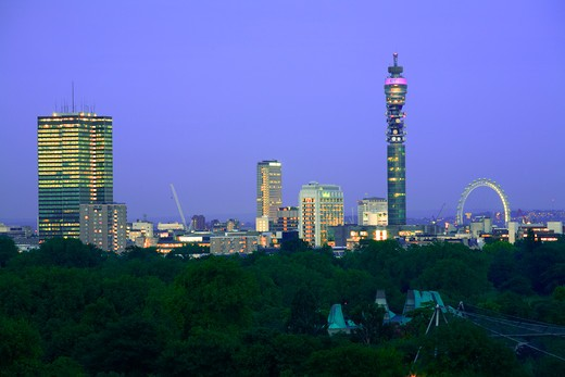 Stock Photo: 4282-20470 England, London, Primrose Hill. A view at dusk from Primrose Hill over Regent's Park towards London's iconic landmarks.