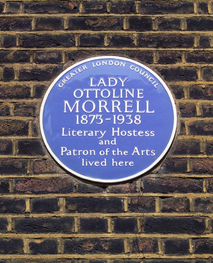 Stock Photo: 4282-20544 England, London, Bloomsbury. A blue plaque celebrating that Lady Ottoline Morrell 1873-1938, a literary hostess and patron of the arts, lived at this address in Bedford Square, London.