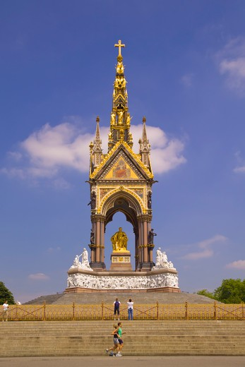 Stock Photo: 4282-20643 England, London, Kensington. A couple jogging past the Albert Memorial in Kensington Gardens.