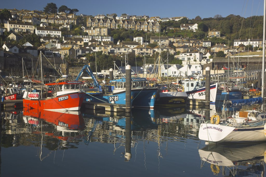 Stock Photo: 4282-20891 England, Cornwall, Newlyn. Reflections of fishing boats in the Cornish fishing town of Newlyn.