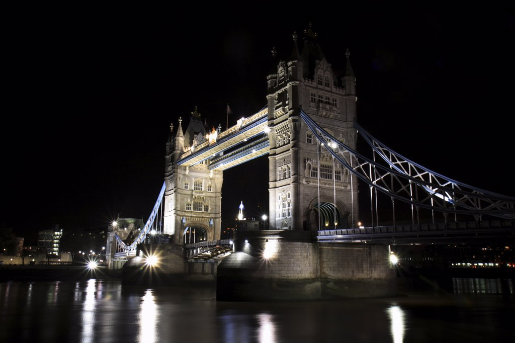 Stock Photo: 4282-21281 England, London, Tower Bridge. A view over the Thames to an illuminated Tower Bridge at night.