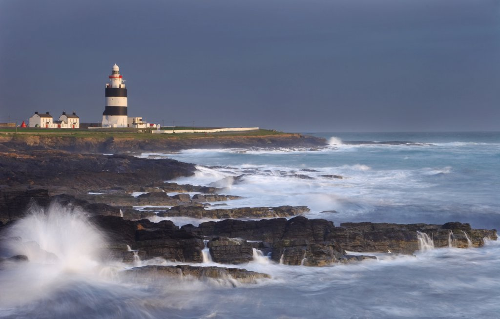 Stock Photo: 4282-21513 Ireland, County Wexford, Hook Head. A view toward Hook Lighthouse. It was built in the thirteenth century as a navigation aid by William Marshall, Earl of Pembroke and is one of the oldest lighthouses in the world.