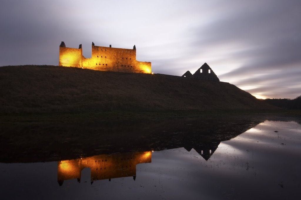 Stock Photo: 4282-21549 Scotland, Invernesshire, Kingussie. Ruthven Barracks at dusk. The castle that once stood on the site of the barracks, was said to be haunted by its notorious lord, who was trapped in limbo playing cards with the Devil.