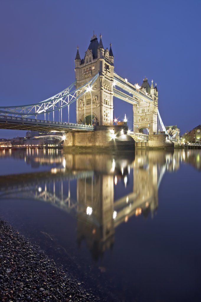 Stock Photo: 4282-21572 England, London, Tower Bridge. Tower Bridge at night. Completed in 1894, it took eight years, five major contractors and the relentless labour of 432 construction workers to build Tower Bridge.