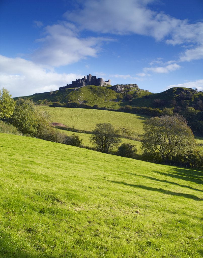 Stock Photo: 4282-21820 Wales, Carmarthenshire, Trapp. View across rolling hills towards Carreg Cennen Castle.