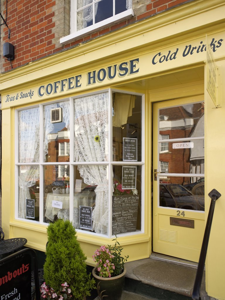 Stock Photo: 4282-21973 England, Suffolk, Lavenham. An English village coffee house. Away from the bustle of the cities, coffee houses in rural communities are for locals and tourists to drink tea, coffee and beverages, snack on a pastry and chat.