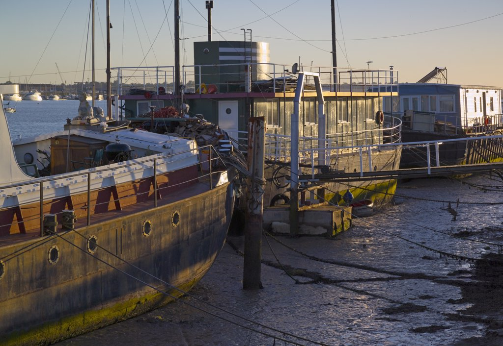 England, Essex, Burnham-on-Crouch. Barges converted to houseboats at Burnham-on-Crouch. : Stock Photo