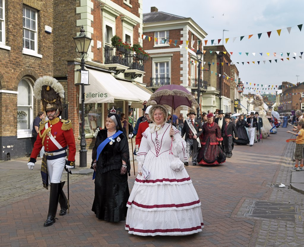 Stock Photo: 4282-22204 England, Kent, Rochester. People parading through Rochester in Victorian costumes at the Dickens Festival 2010.