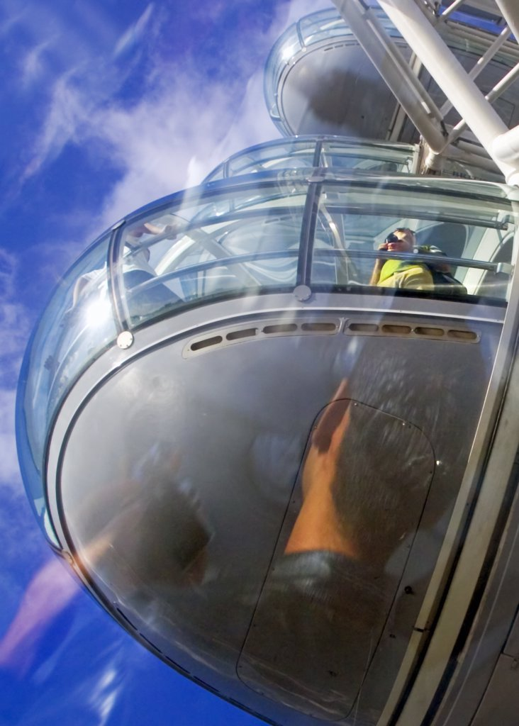 Stock Photo: 4282-22380 England, London, South Bank. Two photographers, one seen in reflection, in a pod on the London Eye.