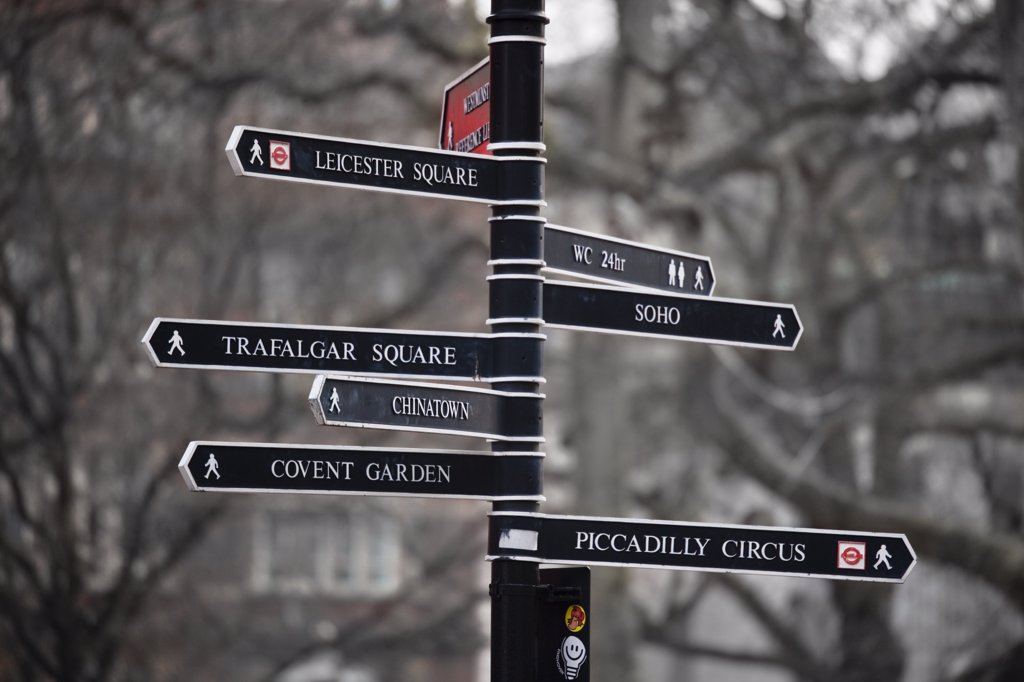 Stock Photo: 4282-22530 England, London, Piccadilly. A black and white metal sign post pointing to many famous places in London.