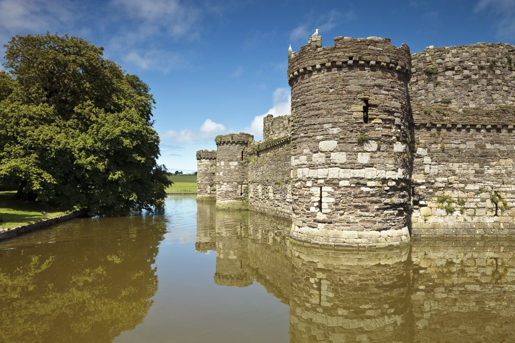 Stock Photo: 4282-22629 Wales, Anglesey, Beaumaris. The outer curtain wall and moat of Beaumaris Castle, the last and largest of the castles to be built by King Edward I in Wales.