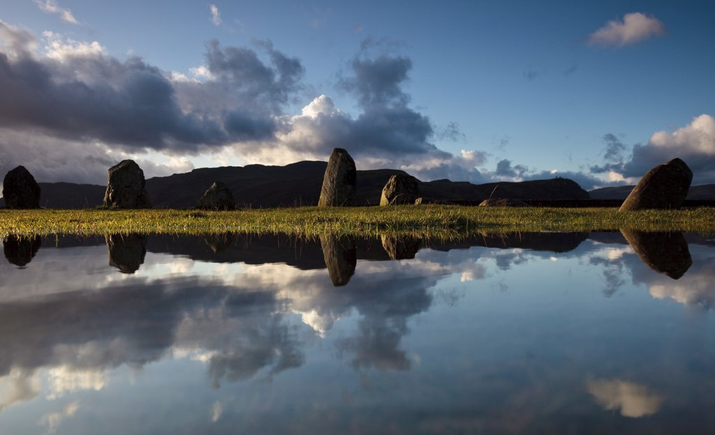 England, Cumbria, near Keswick. Castlerigg Stone Circle, one of the most visually impressive prehistoric monuments in Britain, reflected in a pool of water. : Stock Photo