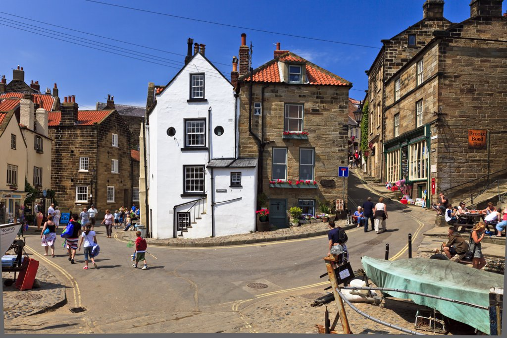 Stock Photo: 4282-22769 England, North Yorkshire, Robin Hood's Bay. Tourists in the centre of Robin Hood's Bay, the busiest smuggling community on the Yorkshire coast during the 18th century.