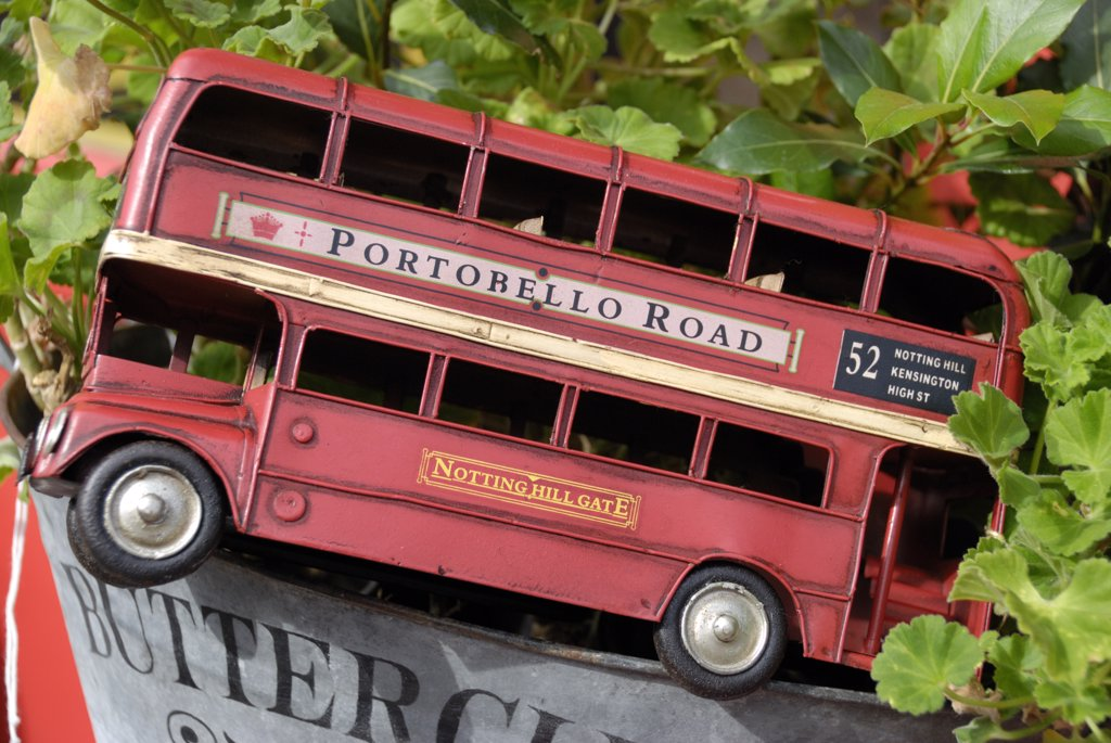 England, London, Portobello Road. Model replica of a red London routemaster double-decker bus in a Portobello Road antiques shop. : Stock Photo