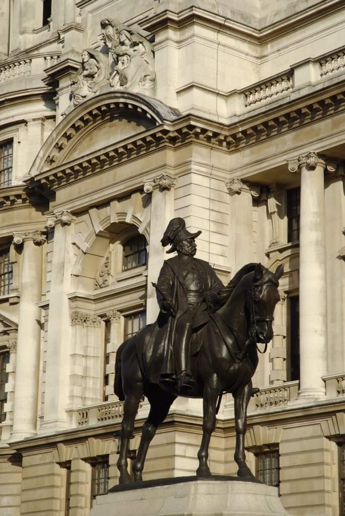 England, London, Westminster. View to a statue of a horseman and classical architecture in Whitehall. : Stock Photo