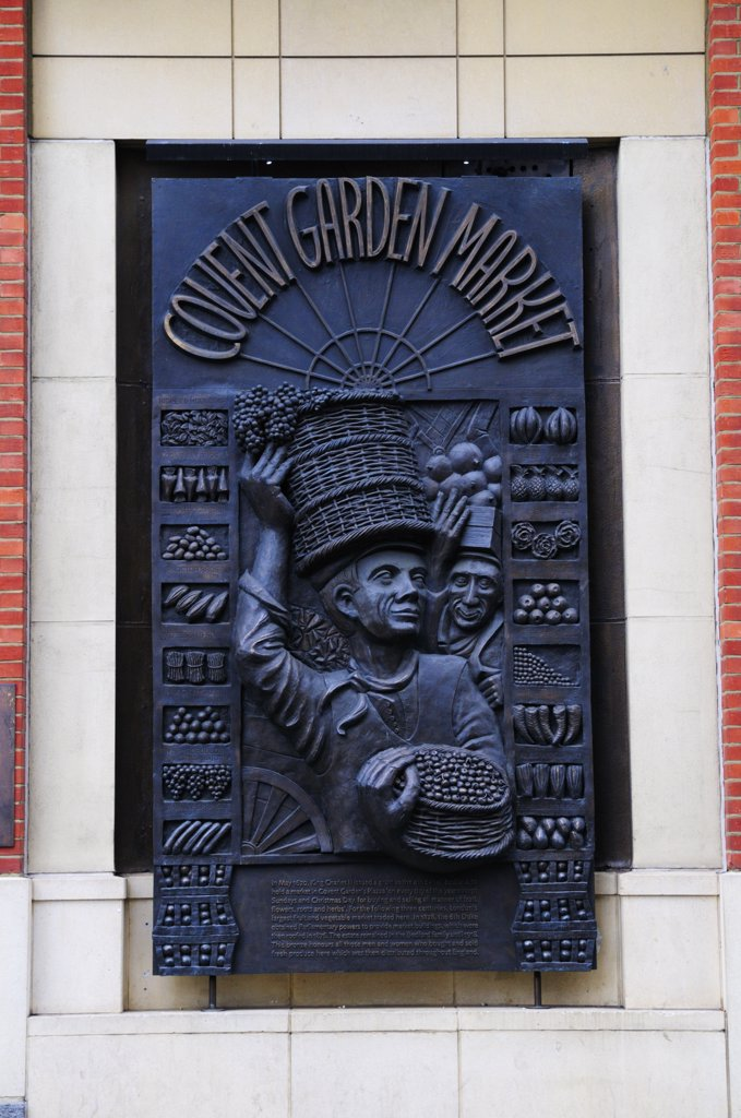 Stock Photo: 4282-2357 England, London, Covent Garden. A bronze wall plaque in Covent Garden honouring all those who bought and sold fresh produce in the market since King Charles ll first issued a grant to do so in 1670.