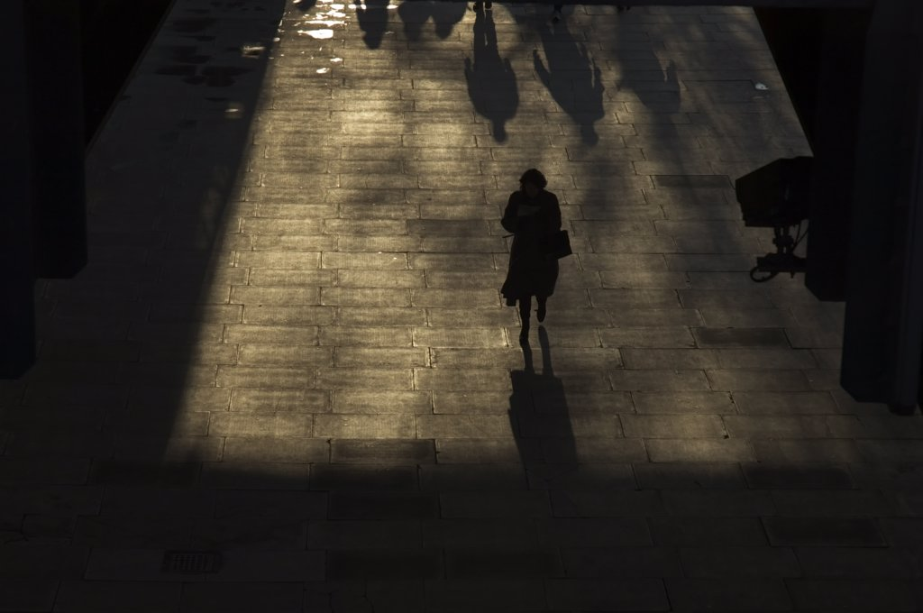 England, London, Westminster. Silhouetted pedestrians walking through an underpass in Westminster. : Stock Photo