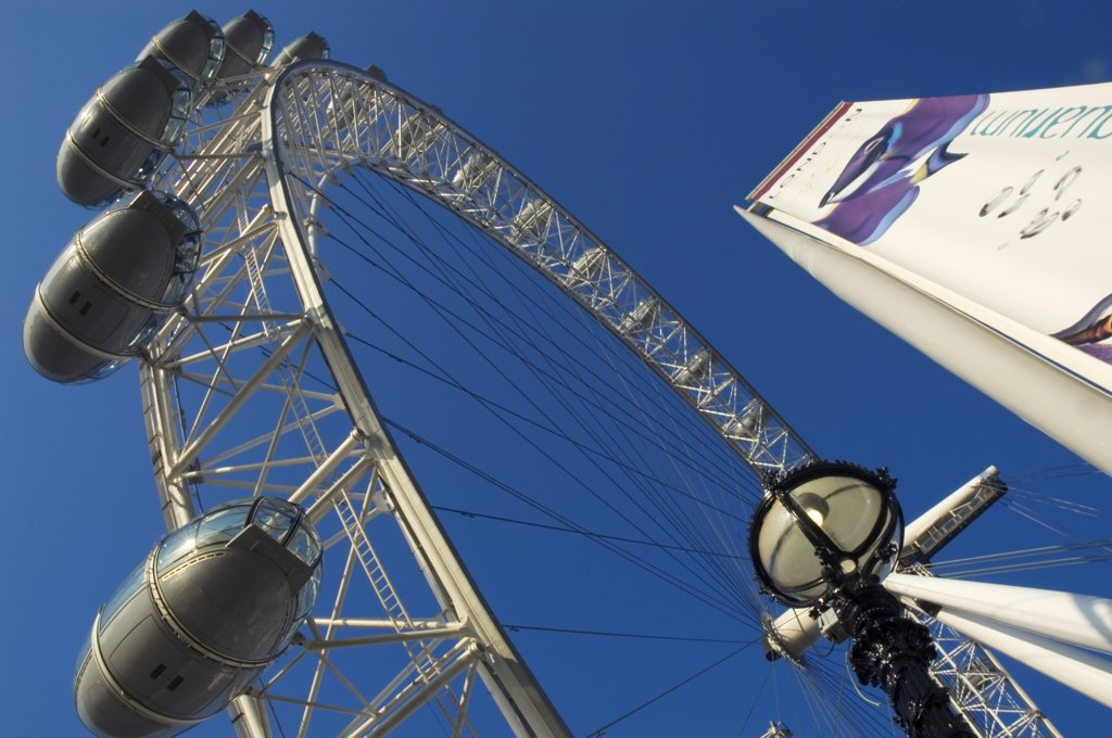 Stock Photo: 4282-23691 England, London, South Bank. Looking up at the London Eye ferris wheel on South Bank.