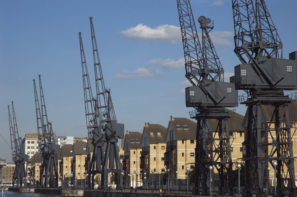 Stock Photo: 4282-23734 England, London, Docklands. Houses and disused cranes at Britannia Village next to Royal Victoria Dock.