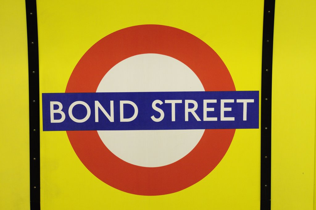 England, London, Bond Street. Bond Street Underground station symbol. : Stock Photo