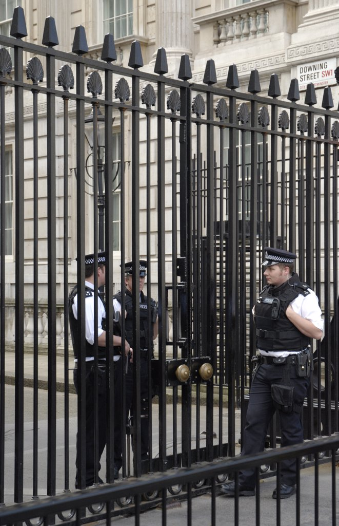 Stock Photo: 4282-23791 England, London, Downing Street. Policemen guarding the gates of Downing Street.